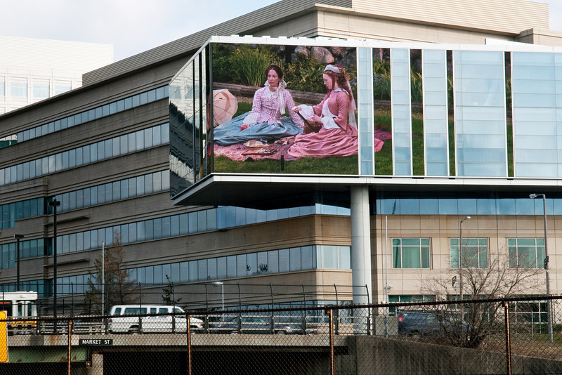 """Production still from """"Louisa May Alcott: the Woman Behind Little Women"""" displayed on WGBH TV headquarters building, Boston, MA"""
