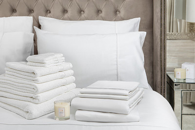 White Bedding Lifestyle With Candle