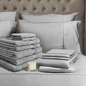 Grey Bedding Lifestyle With Candle