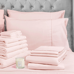 Pink Bedding Lifestyle With Candle Crop