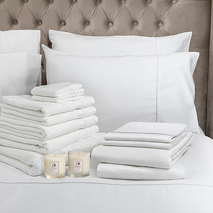 White Bedding Lifestyle With Candle square