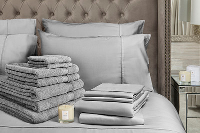 Grey Bedding Lifestyle With Candle Crop