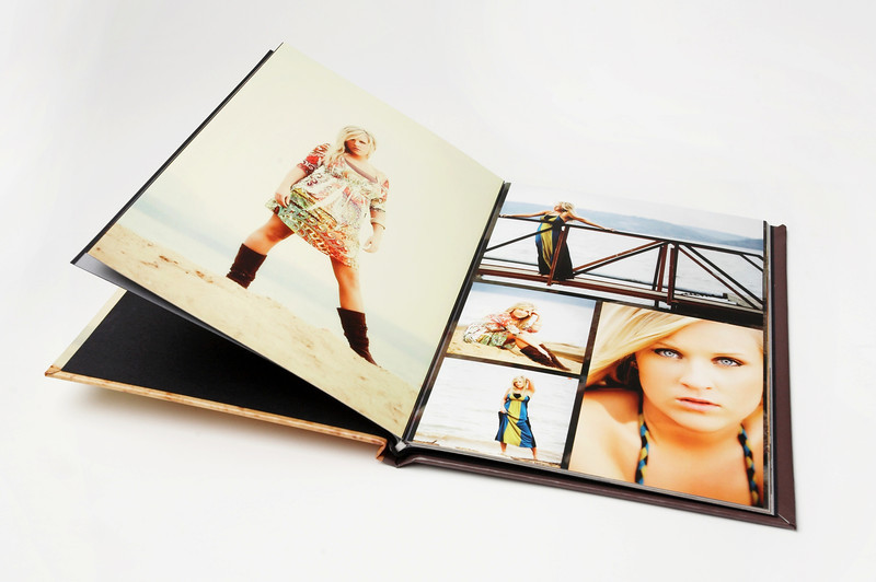 Layflat Book:  Made like the Layflat Album, Layflat books use our premium press papers.  It's made with quality materials like genuine leather and the heaviest hinged paper on the market, and bound so that when opened, it lays flat.