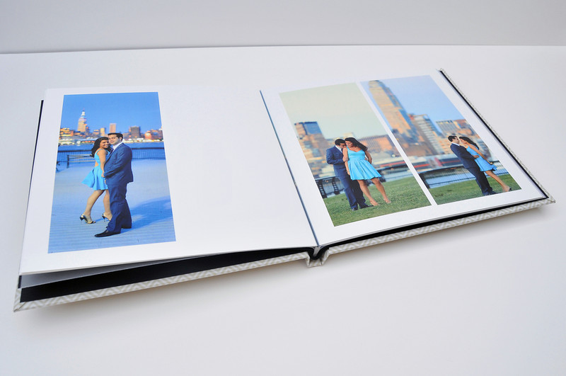 Layflat Album:  Made with the photographic paper, LayFlat Albums give you the same high quality image reproduction as our Signature albums, but at a fraction of the cost. Prints are mounted back to back, offering a lightweight feel to the pages within.