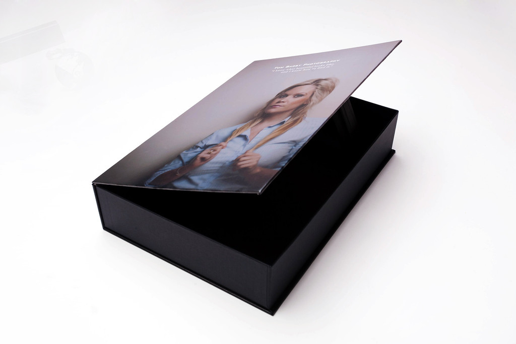<b> Custom Album Box</b> Albums no longer have to be boxed and put away in storage. With Custom Album Boxes, we'll create a one-of-a-kind package that not only protects your album, but also serves as an elegant display.  <b>Sizes</b> - 10x10, 12x12, 10x15