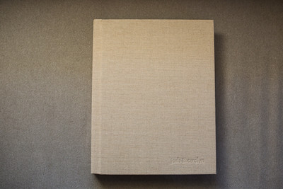 11x14 Flushmount Album covered in a natural linen with debossed lettering