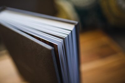 High quality photographic paper adhered to thick pages