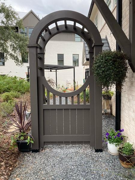 Cedar arbor with a gate