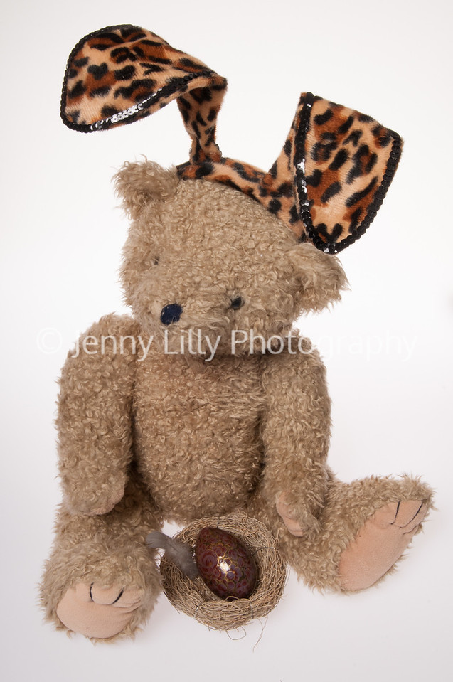 teddy bear dressed as an Easter Bunny isolated on white background