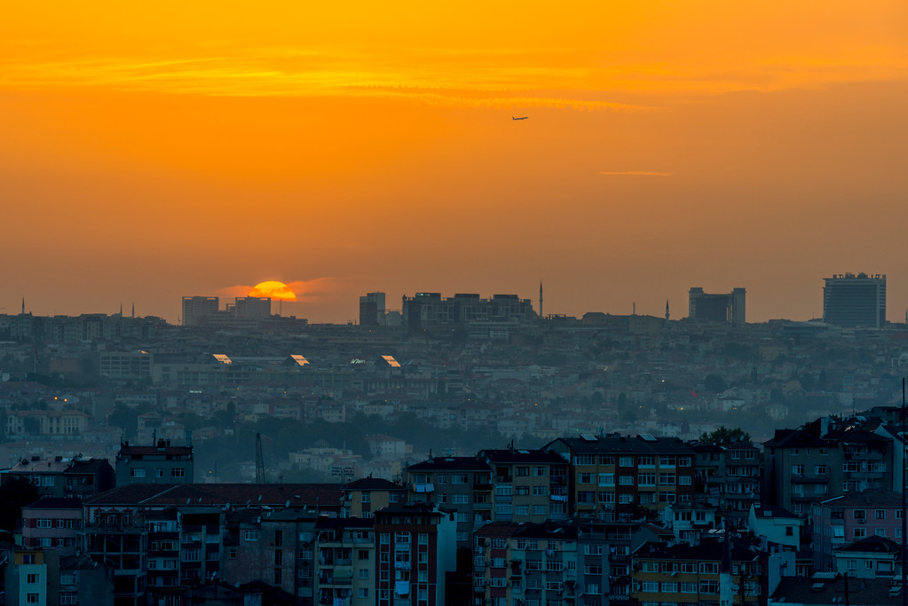 Plane departing Istanbul at sunset