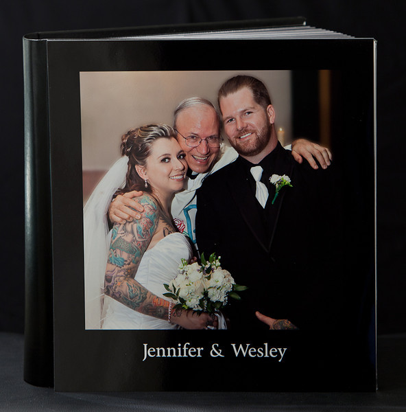 "WEDDING ART BOOK, Hand Crafted in Italy by our premier vendor-GraphiStudio, 12"" x 12"", Lay flat (flush-mount), Acrylic Cover, Fine Grade Leather Spine and Back Cover, Printed on Kodak Endura Metallic Photographic Paper, UV Coated, 60 pages"
