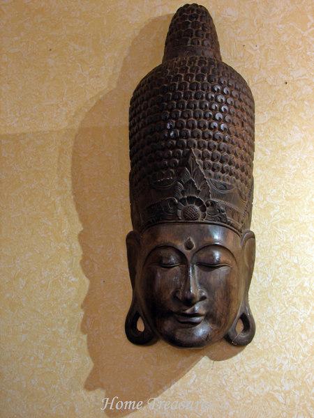 wooden Buddha head sculpture