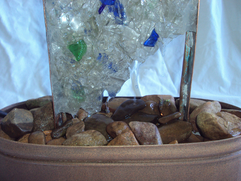 """""""Ice"""" Recycled Glass Panel Fountain -detail image<br /> -water flows down the face and through glass shards of the panel, spashing on river stones<br /> click ahead 1 slide for the video!"""