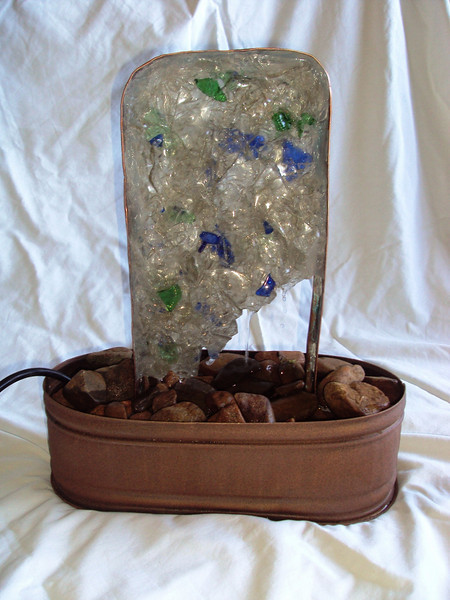 """Ice"" Recycled Glass Panel Fountain<br /> 17"" x 13"" x 6""<br /> -water flows down the face and through glass shards of the panel, spashing on river stones<br /> click ahead 2 slides for the video!"