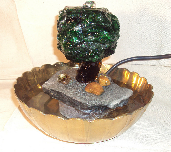 "Tree Fountain using recycled glass<br /> 10"" x 10"" x 10""<br /> -water flows up through center of tree and down the sides<br /> check out the video in the next frame!"