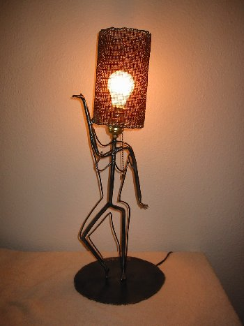 """Dancing Lady Lamp<br /> Steel and electric lighting fixture<br /> 28"""" x 10"""" x 10"""""""