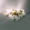 """Falling Leaves"" <br /> Wall Sconce<br /> recycled glass with welded steel bracket, electric light<br /> 14in x 8in x 9in"