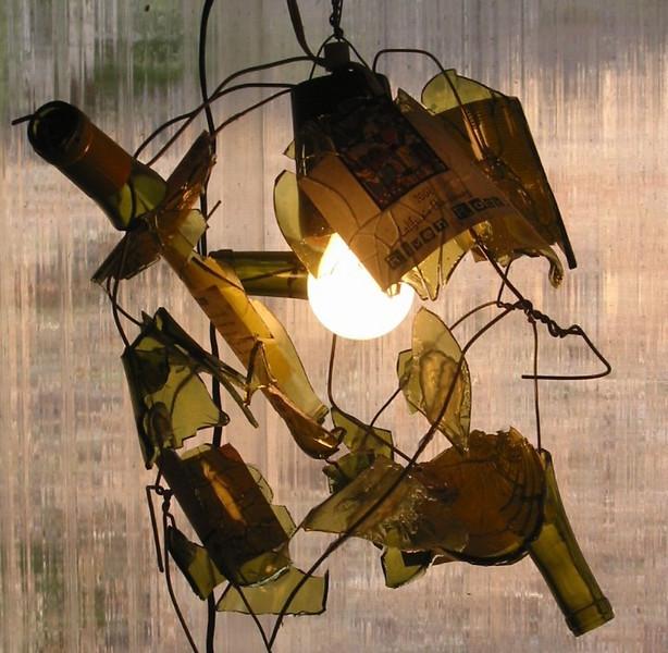 """""""Broken Bottle Chandelier""""<br /> prototype<br /> wine bottle shards, steel wire, electric light<br /> 20"""" x 20"""" x 20"""""""