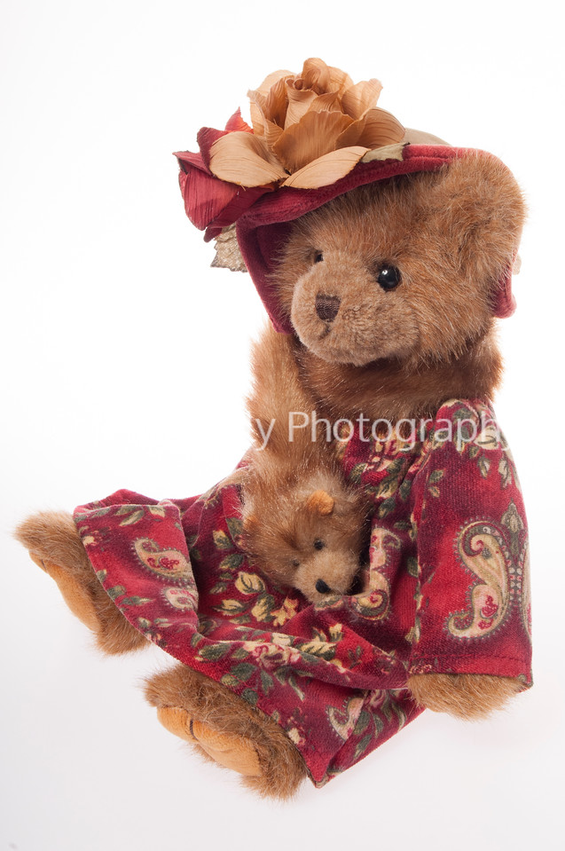 Victorian teddy bear with fur stole isolated on white background