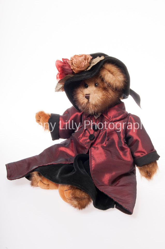 Victorian teddy bear with hat and coat isolated on white background
