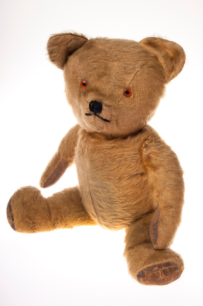 Vintage teddy bear isolated on white background