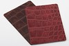 Alligator Leathers in Dark Brown and Dark Red.<br /> <br /> Cover material level: 2