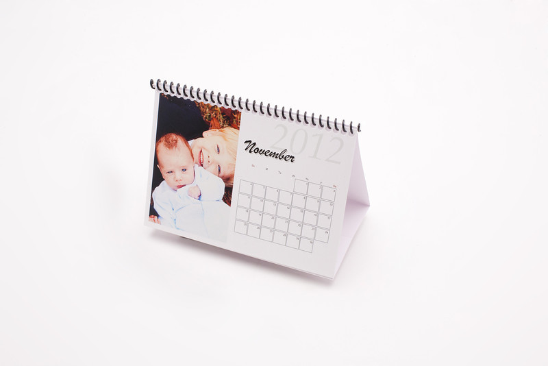 Tented Desk Calendars:  No office is complete without a Tented Desk Calendar. Twelve images can be inserted in the monthly calendar, along with reminders about important occasions.
