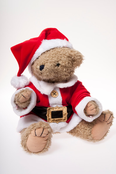 teddy dressed as Santa isolated on white background