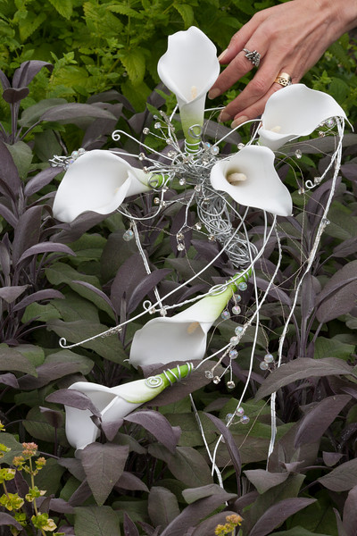 Wedding bouquet of lilies with metal and beads in contemporary style