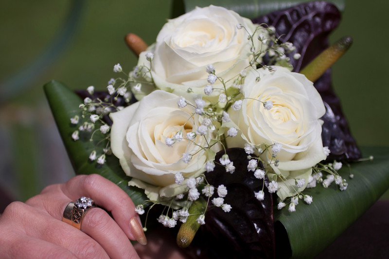 Wedding bouquet of anthuriums, roses and gypsophila