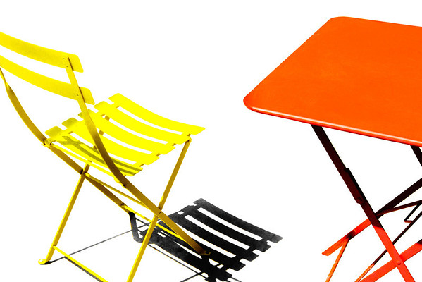 Yellow chair and orange table abstract composition