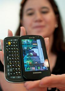 Sprint's Michelle Lee Mermelstein shows off a new smartphone during 2010 interview in Manhattan.