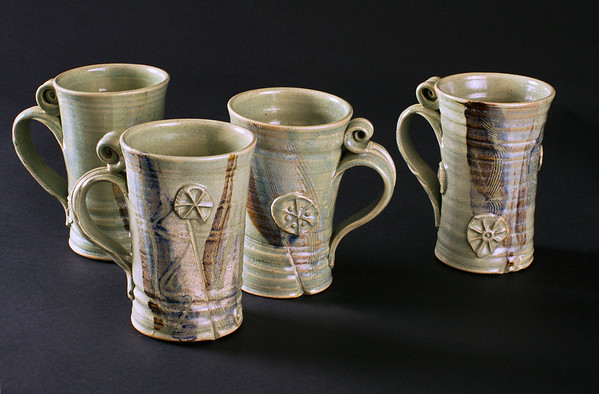 Set of four hand made ceramic mugs