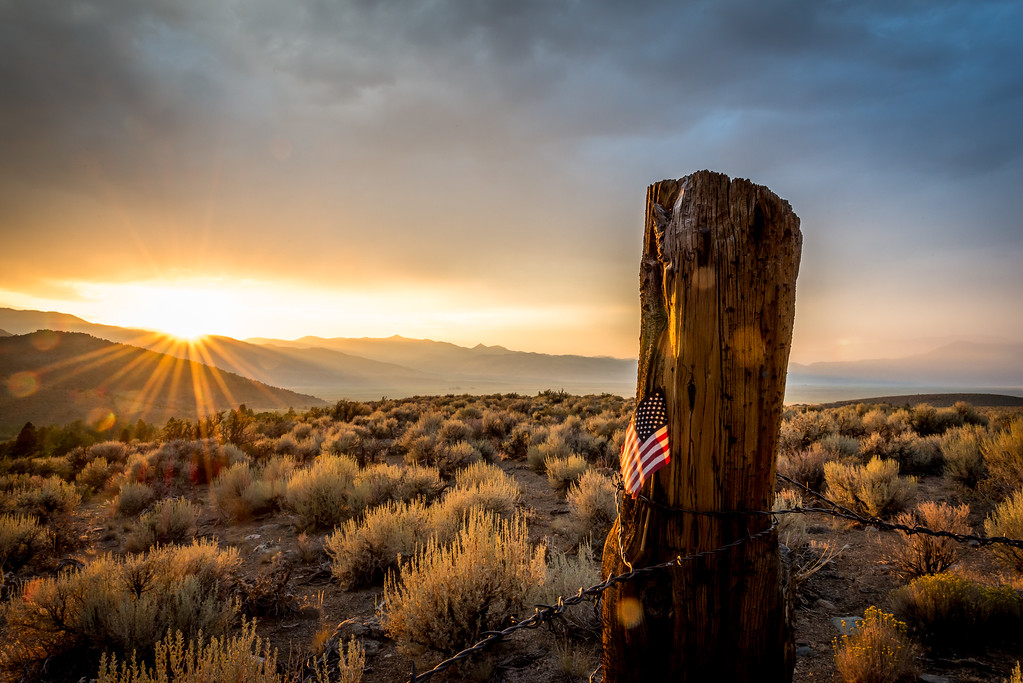 star spangled fence post at sunset