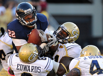 Virginia RB Keith Payne (22) is sandwiched by Georgia Tech defenders at Bobby Dodd Stadium in Atlanta Georgia.  Final Score;  Georgia Tech - 33, Virginia - 21