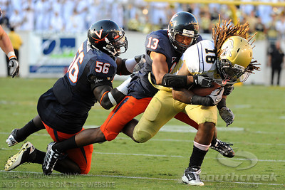 Virginia CB Chase Minnifield (13) snags Georgia Tech BB Anthony Allen, (18) at Bobby Dodd Stadium in Atlanta Georgia.  Final Score;  Georgia Tech - 33, Virginia - 21
