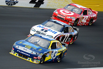 29 May 2010:  AJ Allmendinger in the number 43 Best Buy Ford leads Sam Hornish Jr.in the   number 77 Mobil 1 Dodge and Juan Pablo Montoya in the number 42 Target Chevrolet  out of turn 4 at Charlotte Motor Speedway in Concord, North Carolina. Mandatory Credit: Marty Bingham / Southcreek Global