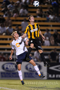 17 July 2010: Charleston Battery defender (5) Nigel Marples  cuts off a pass to Bolton Wanderers midfielder Gavin McCann (19) at Blackbaud Stadium in Charleston, South Carolina.  Final Score;  Bolton 2 - Charleston 0 Mandatory Credit: Marty Bingham / Southcreek Global