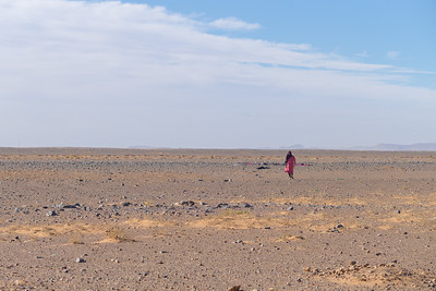 Nomad Woman in Stony Desert