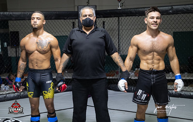 Trayvon Taylor vs David Romano (W)  $ecure Tha Bag at Largo's Minnreg Hall on July 11, 2020.  Combat Quest 8 featured 17  bouts consisting of boxing, San Shou Kickboxing, BJJ, CJJ & MMA. To include Title fights and defenses.  Brandon Lee of Vigilant MMA put on an excellent card. Seating was set appropriately for Social Distancing and everyone was required to wear masks.  Photos by: Joe Mestas www.joemestas.com Available for Promo, events, sports, and photo shoots