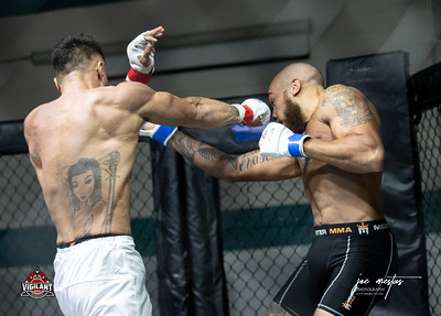 Vashawn Pope (W) vs Jason Gleason  $ecure Tha Bag at Largo's Minnreg Hall on July 11, 2020.  Combat Quest 8 featured 17  bouts consisting of boxing, San Shou Kickboxing, BJJ, CJJ & MMA. To include Title fights and defenses.  Brandon Lee of Vigilant MMA put on an excellent card. Seating was set appropriately for Social Distancing and everyone was required to wear masks.  Photos by: Joe Mestas www.joemestas.com Available for Promo, events, sports, and photo shoots