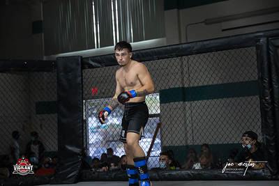 Jesse Romano  $ecure Tha Bag at Largo's Minnreg Hall on July 11, 2020.  Combat Quest 8 featured 17  bouts consisting of boxing, San Shou Kickboxing, BJJ, CJJ & MMA. To include Title fights and defenses.  Brandon Lee of Vigilant MMA put on an excellent card. Seating was set appropriately for Social Distancing and everyone was required to wear masks.  Photos by: Joe Mestas www.joemestas.com Available for Promo, events, sports, and photo shoots