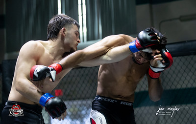 Jesse Romano (W) vs Mauricio Loyo  $ecure Tha Bag at Largo's Minnreg Hall on July 11, 2020.  Combat Quest 8 featured 17  bouts consisting of boxing, San Shou Kickboxing, BJJ, CJJ & MMA. To include Title fights and defenses.  Brandon Lee of Vigilant MMA put on an excellent card. Seating was set appropriately for Social Distancing and everyone was required to wear masks.  Photos by: Joe Mestas www.joemestas.com Available for Promo, events, sports, and photo shoots