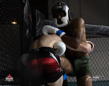Nate Mitchell  (W) vs Michael Larrimore   $ecure Tha Bag at Largo's Minnreg Hall on July 11, 2020.  Combat Quest 8 featured 17  bouts consisting of boxing, San Shou Kickboxing, BJJ, CJJ & MMA. To include Title fights and defenses.  Brandon Lee of Vigilant MMA put on an excellent card. Seating was set appropriately for Social Distancing and everyone was required to wear masks.  Photos by: Joe Mestas www.joemestas.com Available for Promo, events, sports, and photo shoots