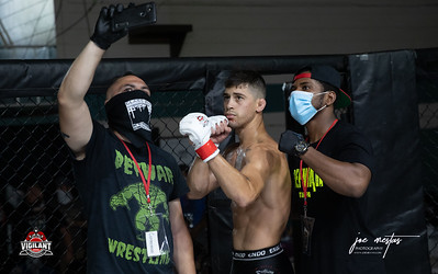Raydell  Garcia  vs Adam Amado (W)  $ecure Tha Bag at Largo's Minnreg Hall on July 11, 2020.  Combat Quest 8 featured 17  bouts consisting of boxing, San Shou Kickboxing, BJJ, CJJ & MMA. To include Title fights and defenses.  Brandon Lee of Vigilant MMA put on an excellent card. Seating was set appropriately for Social Distancing and everyone was required to wear masks.  Photos by: Joe Mestas www.joemestas.com Available for Promo, events, sports, and photo shoots