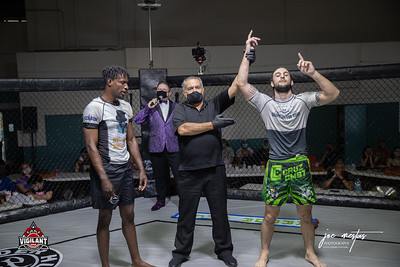 Tyler Jones  (W) vs Jino Ciprius  $ecure Tha Bag at Largo's Minnreg Hall on July 11, 2020.  Combat Quest 8 featured 17  bouts consisting of boxing, San Shou Kickboxing, BJJ, CJJ & MMA. To include Title fights and defenses.  Brandon Lee of Vigilant MMA put on an excellent card. Seating was set appropriately for Social Distancing and everyone was required to wear masks.  Photos by: Joe Mestas www.joemestas.com Available for Promo, events, sports, and photo shoots