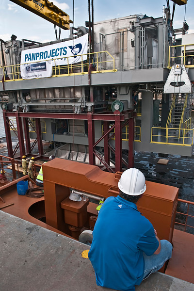 Looking on as coke processing equipment is off-looaded onto barge - Happy Diamond ship - Panprojects/Thyssen-Krupp Uhde Project - Port of Mobile, AL