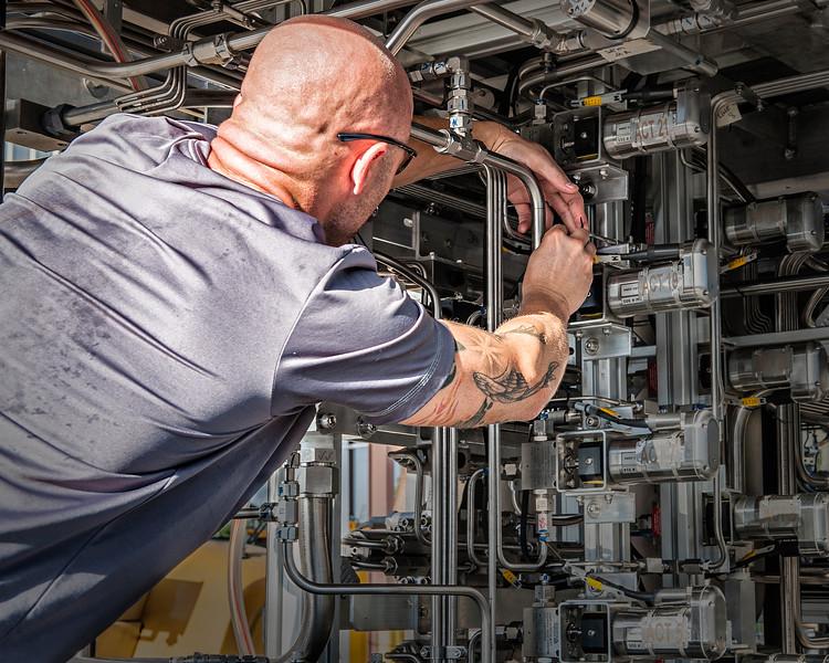 'Spaghetti Warehouse' - Technician adjusts complex subsea equipment