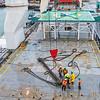 Rigging spreader bar in preporation for crane lift