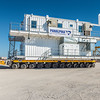 60 ton Cometto SPMT (Self Propelled Module Transporter) transporting crew quarters module to barge